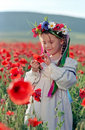 Little Girl On Red Poppy Field Royalty Free Stock Images - 14700559