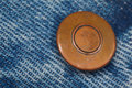 Piece Of Blue Denim Structure Of The Yellow Button Royalty Free Stock Photos - 14754308