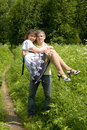 Man With Woman On Hands On Summer Meadow Stock Images - 14755854
