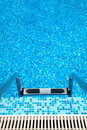 Part Of Swimming Pool With Ladder Royalty Free Stock Photo - 14824955