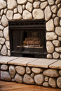 Gas Fireplace With Big Rocks On Wall Stock Images - 14888854