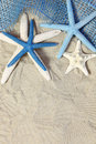 White And Blue Sea Stars On Sand Stock Photo - 15004660