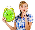 Girl With The Clock Asking Us To Maintain Silence Royalty Free Stock Photography - 15017777
