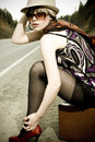 Girl Hitchhiking With Suitcase Royalty Free Stock Image - 15236966