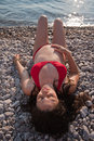 Pregnant Woman Lying On A Rocky Beach Stock Image - 15340741