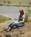 Girl With Laptop At Rock Near Lake And Tree. Royalty Free Stock Photos - 15403368