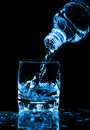 Water Splashing From Bottle Into Glass Royalty Free Stock Photo - 15425825