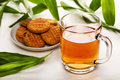 Cup Of Black Tea And Biscuits Stock Photos - 15426153