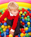 Boy In Colored Ball. Royalty Free Stock Photos - 15471208