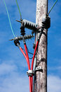 Electricity Pole With Red Cables Royalty Free Stock Photos - 15485378