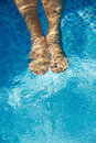 Feet Refreshing In Swimming Pool Stock Images - 1554554