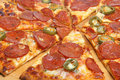Pepperonni Pizza With Green Chilli Peppers Royalty Free Stock Image - 15507956