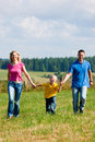 Family Running On Meadow In Summer Royalty Free Stock Images - 15583549