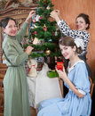 Family Decorating Christmas Tree At Home Royalty Free Stock Photo - 15586465