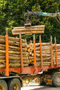 Truck Manipulating Wood Royalty Free Stock Images - 15640589