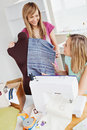 Delighted Women Sewing At Home Royalty Free Stock Images - 15647489