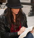 Close Up Of Urban Woman Reading In City Stock Photo - 15673720