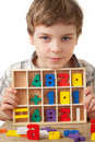 Boy Displays Wooden Figures In Form Of Numerals Royalty Free Stock Photo - 15690425
