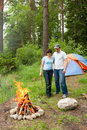 Young Pair At A Fire In A Forest Stock Photo - 15725830