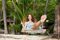 A Woman On A Swing Royalty Free Stock Image - 15749406