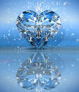 Heart Shaped Diamond Over Blue With Reflection Stock Photos - 15777463