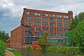Old British Mill On The Canalside Royalty Free Stock Images - 15782309