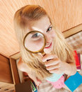 Girl With Magnifier Royalty Free Stock Photo - 15792425