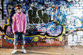 Young Teenager Against Graffiti Wall. Royalty Free Stock Images - 15816259
