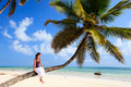 Young Woman Sitting On Palm Tree Royalty Free Stock Image - 15903946