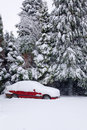 Red Car Covered In Snow Stock Image - 15940491