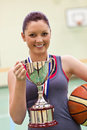 Young Woman Holding A Trophy And A Basket Ball Stock Photo - 15970640