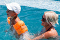 Woman And Little Boy Bathes In Pool Stock Photography - 15992982