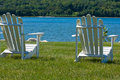 Two Adirondack Chairs By The Lake Stock Image - 16036361