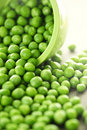 Spilled Bowl Of Green Peas Stock Photo - 16043380