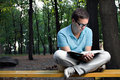 Young Man Reading Book Royalty Free Stock Photography - 16105827