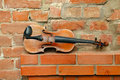 Old Violin And Empty Brick Wall Stock Image - 16109551