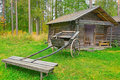 Old Wooden Cart In Front Of Log Barn Stock Image - 16113891