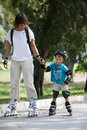 Mother And Son Rollerskating Royalty Free Stock Photo - 16177865