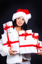 Santa Girl Holding The Box With Gifts. Royalty Free Stock Images - 16207129