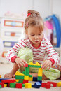 Child Playing With Bricks Royalty Free Stock Images - 16221979
