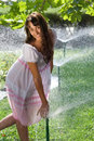 Girl With Sprinklers Royalty Free Stock Image - 16228776