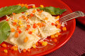 Ravioli Topped With Diced Red, Yellow And Orange Peppers With Ba Stock Photos - 1637953