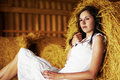 A Tired Brunette Girl Is Relaxing On A Pile Of Hay Royalty Free Stock Photo - 16480265