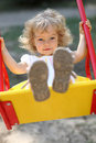 Child On Swings Royalty Free Stock Images - 16488159