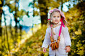 Pretty Little Girl With Bagels In Autumn Park Stock Photography - 16577692