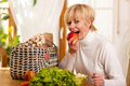 Woman With Groceries Eating Apple Stock Photo - 16583050