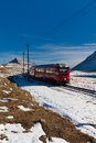 Red Train And Mountains Royalty Free Stock Photography - 16625087