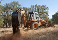 Backhoe Out In The Field Stock Images - 16679724