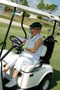 Senior Woman Driving Golf Cart Royalty Free Stock Image - 1674446
