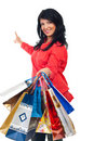 Happy Woman With Shopping Bags Pointing To Copy Stock Photo - 16713170